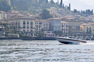 Skipper driving his boat in front of Bellagio Lake Como