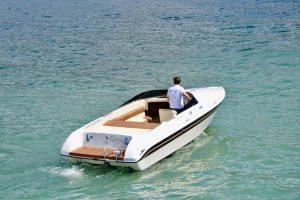 Skipper driving his Bellagio boat on Lake Como